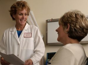 Doctor with Patient [Photo Courtesy: Wikimedia Commons]
